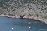 Вид с крепости Чембало на 825ГТС Балаклава Выход из тоннеля для подводных лодок